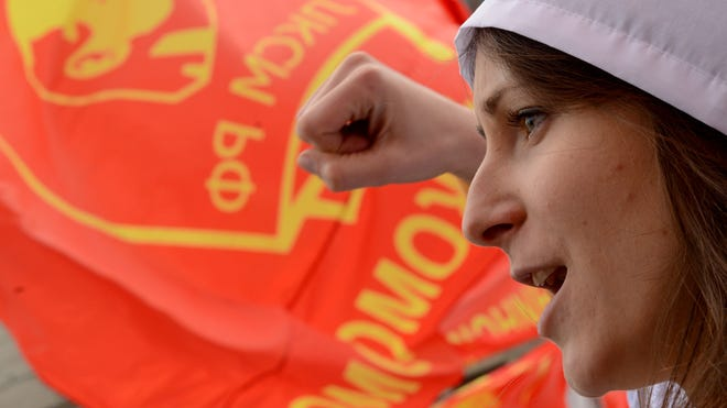 A Russian Communist party activist takes part in a May Day rally in 2013.