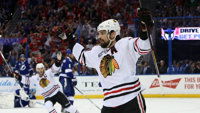 Jun 13, 2015: Chicago Blackhawks left wing Patrick Sharp (10) celebrates after scoring a goal against the Tampa Bay Lightning in the first period game five of the 2015 Stanley Cup Final at Amalie Arena.