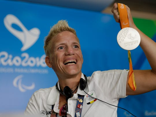 FILE - In this Sept. 11, 2016, file photo, Belgium's Marieke Vervoort poses for the photo as she holds her silver medal at a press conference during the Rio Paralympic games in Rio de Janeiro, Brazil. Paralympian Vervoort said when the day arrived, she had signed the euthanasia papers and was prepared to end her life. The time came Tuesday, Oct. 22, 2019, in her native Belgium, her death confirmed in a statement from her home city of Diest. (AP Photo/Leo Correa, File)