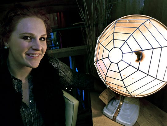 Kendra Matusiak, of REmix Design, shows off her upcycle