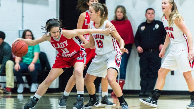 Franklin's Sam Hoyle dribbles around Pisgah's Lani Woods during their game Friday, January 12, 2018.