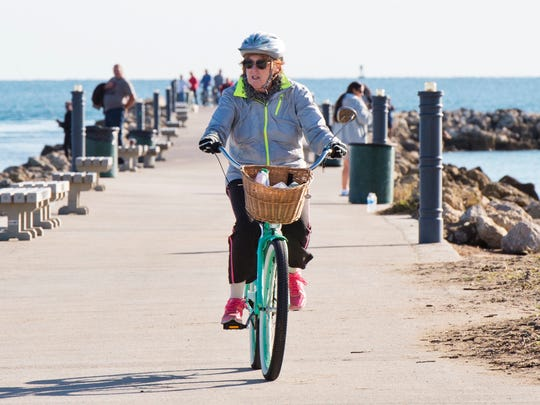 """I've got my jacket, scarf and mittens on today,"" said Diane Seymour, a full-time resident of Fort Pierce, who biked along the Fort Pierce South Jetty during a cold snap in January 2017."