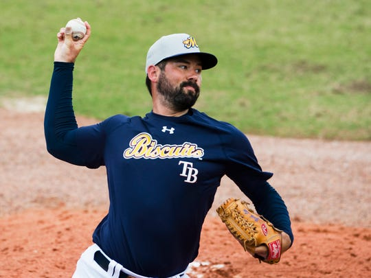 Biscuits pitcher Zach Lee throws a pitch during the Biscuits opening practice on Tuesday, April 3, 2018, in Montgomery, Ala.