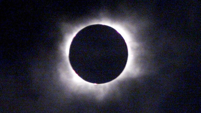 Shown is the solar eclipse above Gmunden, Austria, on Aug. 11, 1999. The moon smothered the light of the sun as the last total solar eclipse of the millennium swept across Europe toward the Bay of Bengal.