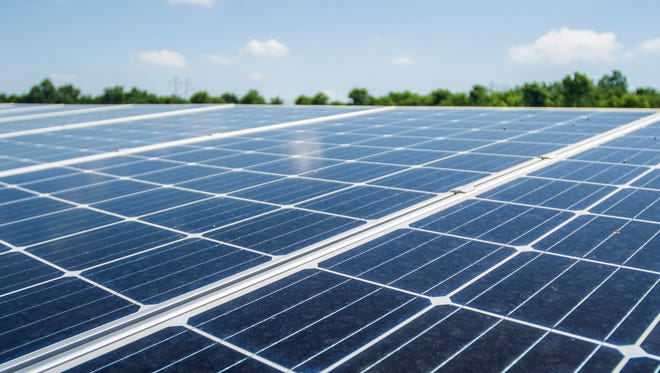 Solar panels are seen at an Indiana Municipal Power Agency solar farm on the far-east side of Richmond on Friday, June 29, 2018.