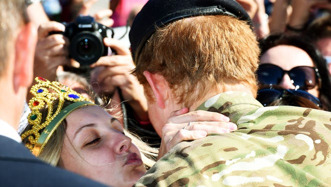 Britain's Prince Harry get a smooch from a serious fan.