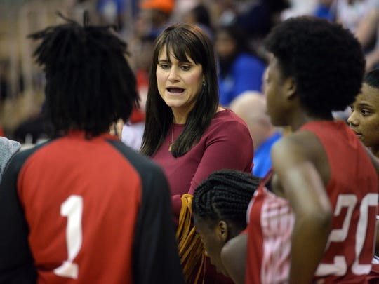 Ruston head coach Jenna Bolin talks with her team as they take on Southwood in the LHSAA Class 5A playoff opener.