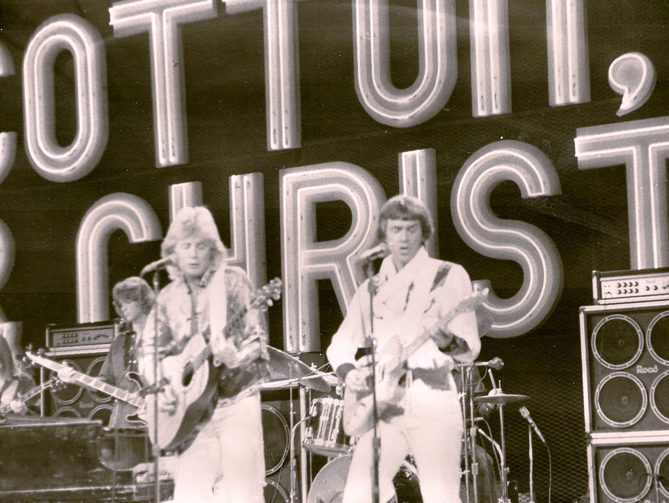 Chris Christian, right, performs as a member of Cotton,