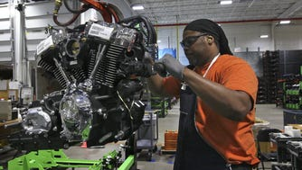 Michael Guster inspects and readies a new Harley-Davidson Milwaukee-Eight engine at the Pilgrim Road engine plant.