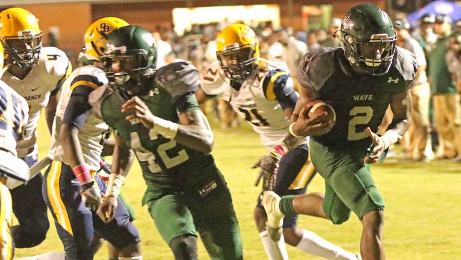 West Point's Marcus Murphy (2) breaks through the Olive Branch's defensive line to score a touchdown during the first half of their Friday night Oct. 13, 2017 football game in West Point, Ms. (Special to the Clarion Ledger/Jim Lytle)