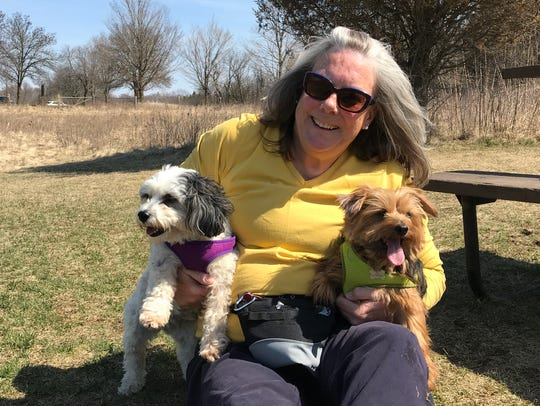 Linda Niedziejko, a retired nurse from Summit, poses with her dogs, Tilly (left), a Havanese, and Margie, a Yorkshire terrier, last year at the Nashotah Park dog exercise area. The Nashotah Park dog park is one of three operated by Waukesha County. The county is looking into adding another at Menomonee Park in Menomonee Falls.