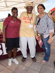 Dawn Bloomfield, left, Wilmer Europe and Angela Hayle volunteer at the 2017 Treasure Coast Jerk Festival at the Port St. Lucie Civic Center.