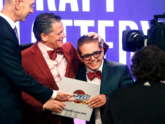 FILE - In this May 21, 2013, file photo, Cleveland Cavaliers owner Dan Gilbert congratulates his son, Nick Gilbert, after the team won the NBA basketball draft lottery in New York. Nick Gilbert will undergo major brain surgery this week. A team spokesman said the 21-year-old Michigan State student will have the operation in Detroit. (AP Photo/Jason DeCrow, File)