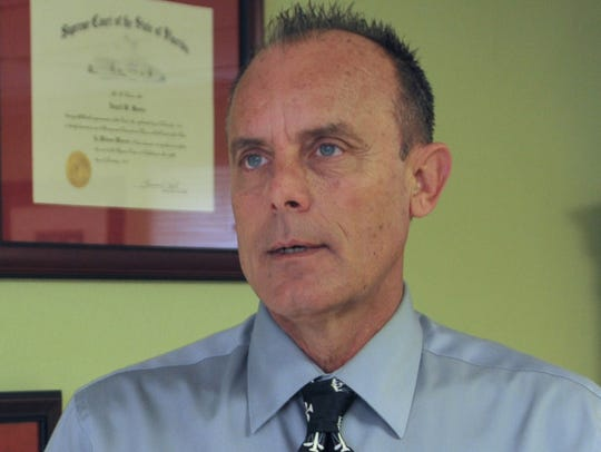 Vencil W. Moore, P.A., works at his office in Cocoa.