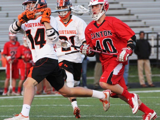 Northville's Brendan Hicks (left) winds up for a shot with Canton's Ben Phillips in pursuit.