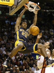 Indiana's Ron Artest (All-Star in 2003-04) slams home