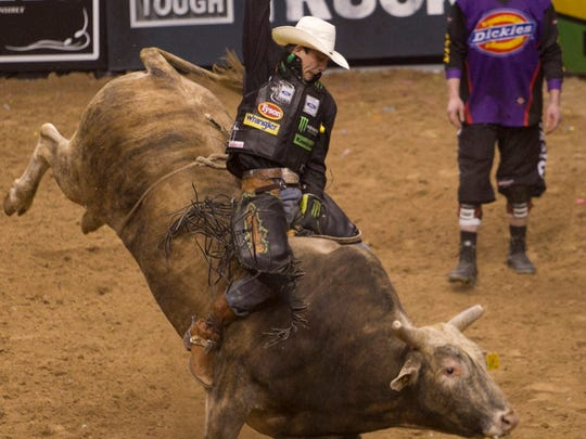 J.B. Mauney rides a bull in the Championship round as he goes on to win the PBR event at US Airways Center on Sunday, March 9, 2014 in Phoenix, Az.