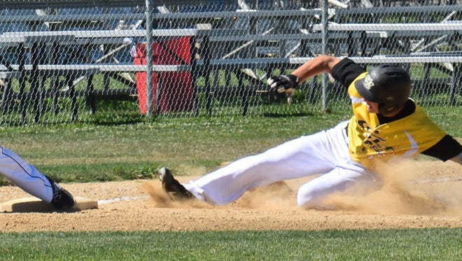 The Colt 45s Austin Lively slides into third as Solano third baseman Kyle Paguio gets ready to apply a late tag in a 9-run Colts first inning. The Colt 45s went on to win 15-5.