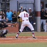 Tate's Trace Penton lets a ball go past him during the Region 1-7A semifinal game Tuesday night at Tate High School.