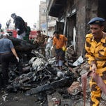 A Yemeni soldier assists in the clear up operation after a car bomb exploded leaving 13 people dead in Sanaa. The huge blast targeted Yemen's Minister of Defense who survived the attack. Four vehicles were destroyed and nearby shops burnt out. 09/11/2012