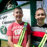 Fifth-graders Kyle Sturdy, 11, left, and Jacob Van Ert, 11, put on their safety patrol belts outside of their classroom at Vesper Community Academy, Thursday, April 30, 2015. Sturdy and Van Ert went to Washington D.C. on a safety patrol trip.