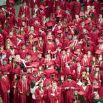 Graduates wait to take their seats during City High commencement at Carver-Hawkeye Arena in Iowa City Sunday, May 24, 2015.