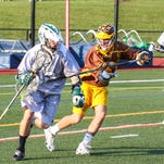 Action from the Vestal vs Canton boys lacrosse game