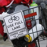 note fastened to a bicycle basket prior to the start of Bridging Greater Lafayette: Taking the Lane Saturday at Riehle Plaza in Lafayette. On Monday, the Lafayette City Council could approve the Bike and Pedestrian Master Plan.