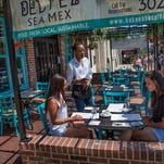 Patrons eat at a restaurant on Main Street in Newark.