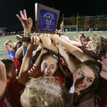 Jackson Prep players celebrate after defeating JA 2-1. Jackson Prep played Jackson Academy in the Division 1 Girls Soccer Championship on Monday.