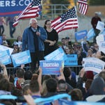 Presidential hopeful Bernie Sanders leads a rally for supporters before the Iowa Democratic Party's Jefferson Jackson Dinner on Saturday, Oct. 24, 2015 in Des Moines.