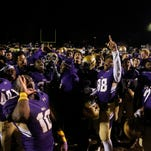 Male players celebrate after defeating Trinity, 20-19, on Nov. 20, 2015, at Male's Maxwell Stadium. 20-19.