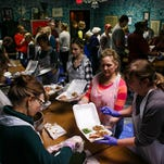 250 Volunteers work to put out an estimated 4,000 Thanksgiving meals as part of the Parks Community Thanksgiving dinner at Chucks Restaurant on Thursday, November 26, 2015 in Des Moines.