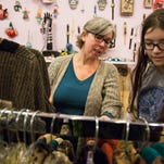 Malanie Kidwell, left, and Annie Kidwell shop at Sister Dragonfly Gallery on Frankfort Ave. during Small Business Saturday, Nov. 27, 2015, in Louisville, Ky.