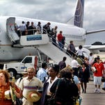 The first passengers of the first flight of Continental Airlines from Miami Florida, arrives at the Jose Marti Airport of Havana, Cuba on Nov. 1, 2001. The United States and Cuba have reached an understanding on restoring regularly scheduled commercial flights, Cuban and American officials said Wednesday, Dec. 16, 2016 on the eve of the anniversary of detente between the Cold War foes.
