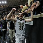 Dakota Mathias and the rest of the Boilermakers slap hands with fans after defeating Vanderbilt 68-55 Tuesday, December 22, 2015, at Mackey Arena.