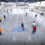 Skaters manuever on the ice at Nasser Civic Ice Rink Saturday, one day after the rink reopened after a more than 40-day hiatus.