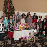 Megan Shreve and Iris Lugo Agosto are pictured seated. Pictured in the front row are: Tiffany Mellott, Caroline Mintmier, Victoria Virtue, Mariela Aviles-Martines, and Santa (Adam Spurrell). Pictured in the second row are: Jaquelyn Canino, Diane Wagner, Kassandra Hansen, Andrea Proulx, Lucy Carter, Annie Laughlin, Teri Byers, Melody Hake, Rebecca Kiehl, Erin Sheehy, Rita Tuchalski, and Steve Sexton. Pictured in the back row are:  Josh Keeney, Chuck Moran, Andrew Laughlin, Adam Birdsall, Sandi Hoylman, Christine Greiner, and Megan Wherley.