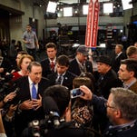 Former Gov. Mike Huckabee speaks to media after the Republican debate at the Iowa Events Center in Des Moines, Thursday, Jan. 28, 2016.