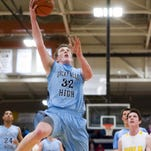 Brendan Howard leaps for a layup during the game against Billings West in Swarthout Fieldhouse Saturday.