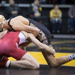 Iowa's Brody Grothus grapples with Indiana's Tommy Cash in weight class 141 at Carver Hawkeye Arena in Iowa City Friday, February 5, 2016. Grothus pinned Cash with 30.5 remaining in the first period.
