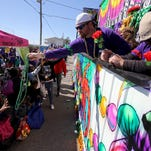 A shooting after the St. Paul Carnival Association parade left two dead and at least four injured in Pass Christian, Miss., on Sunday, police said. (Amanda McCoy/The Sun Herald via AP)