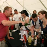 Hector Wine Co. co-owner and winemaker Justin Boyette pours a sample at Seneca Lake Wine and Food 2013.
