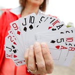Meals on Wheels board member Angela Cavaluzzi shows off the cards not yet selected Saturday at the non-profit's annual Poker Ride.