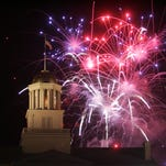 In this file photo from 2008, fireworks are seen by the dome of the Old Capitol building on the University of Iowa campus.