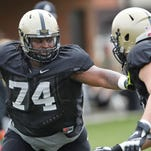 Offensive lineman Martesse Patterson blocks teammate Colton Bahamonde during Purdue spring football practice Tuesday, April 14, 2015, at the Bimel Practice Complex on the campus of Purdue University.
