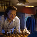 "James McAvoy, left, as Charles Xavier in a scene from ""X-Men: Days of Future Past."""