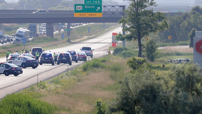 Police block I-41 northbound because of a vehicle rollover Tuesday, June 26, 2018, in Appleton, Wis.