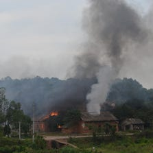 LILING, CHINA - SEPTEMBER 22: The image shows the smog caused by an explosion at Nanyang Export Fireworks Factory in Baofeng Village on September 22, 2014 in Liling, Hunan Province of China. Twelve people have been confirmed dead and 33 injured in an explosion at Nanyang Export Fireworks Factory in Baofeng Village of Liling City in central China's Hunan Province on Monday morning. The causes of the explosion is under investigation.