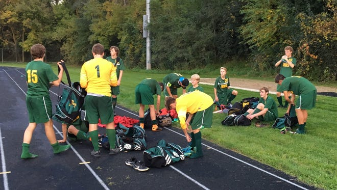 Howell soccer players pack up to head home after their district game at Pinckney was postponed because officials never showed up.